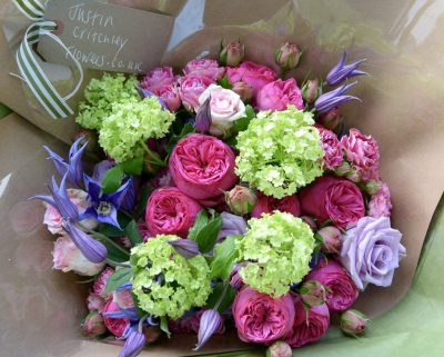 Luxury bouquet of garden roses, spray roses, guelder rose and clematis.