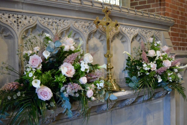 Wedding flowers Pink rose arrangements on alter.