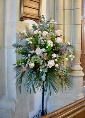 Church wedding pedestal arrangement.