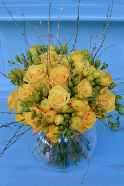 Luxury Golden Wedding Anniversary bouquet of yellow roses, ranunculus, freesia and gold birch twigs.