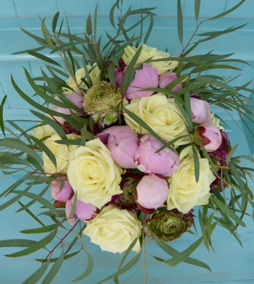 Luxury bouquet of peonies, roses, ranunculus and eucalyptus.