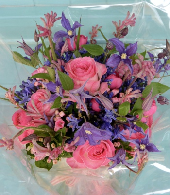 Candy pink avalanche roses with clematis and agapanthus.