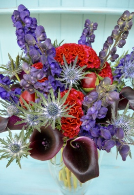 Spiky dark and punky bouquet of red and purple flowers.