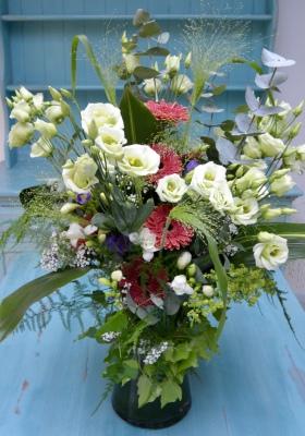 Tall vase arrangement of summer flowers.
