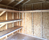 Customized small shelves and a wrap-a-round large high shelf for a shed.