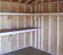 Customized wrap-a-round shelf and workbench for a shed with an upgraded interior.