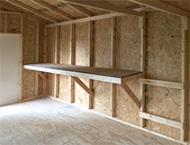 Customized workbench and tool storage for a Five Star shed.