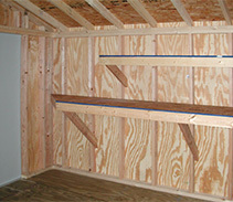 Customized small shelf and angled workbench for a Five Star shed with an upgraded interior.