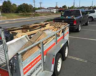 Lumber from an old shed loaded and ready to be hauled away.