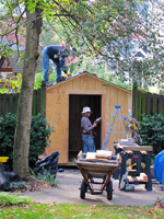 Building and caulking a backyard storage shed.