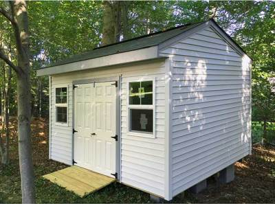 A 14x10x9.5 Elite design storage shed with fiberglass French shed doors.
