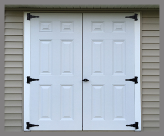 Close up of new fiberglass French shed doors in white.