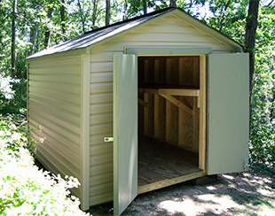 8x10x8 garden shed with doors open showing custom shelf to store a canoe.