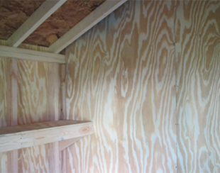 Interior dividing wall of a 10x15x9 storage shed.