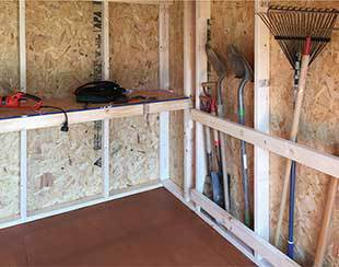 Interior shelving and storage for garden tools in a 10x12x9.5 shed.