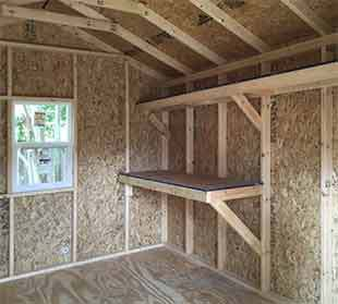 Interior shelving in a 10x12x9.5 storage shed.