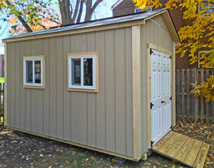 Side view of an 8x12x9 garden shed with fiberglass doors.