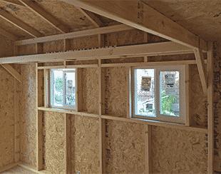 Interior custom shelving of an 8x12x9 garden shed.