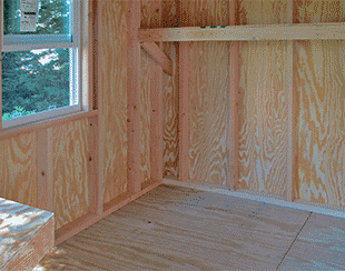Interior of an 8x12x8 playhouse and garden shed combo  with a dividing wall.