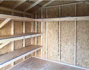 Customized interior shelving in the 10x12x9.5 storage shed.