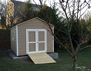 10x12x9.5 storage shed with vinyl siding.