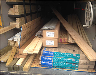 Lumber for a 16x10x9.5 stacked inside our utility trailer awaiting delivery.