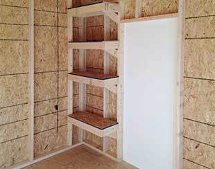 Interior shelves custom built for dance studio storage.