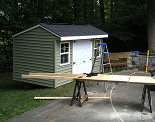 Side view of a 12x8x8 shed for toy cars and sporting equipment storage.