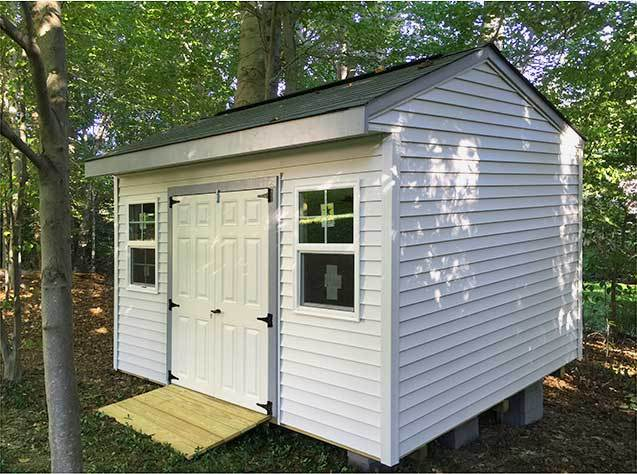 12x10x9.5 garden shed with fiberglass doors. This is our cottage style Elite design.