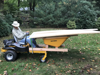 """Lumber for a shed stacked on """"Li'l Mule"""" - Five Star Shed's specially designed wheelbarrow."""