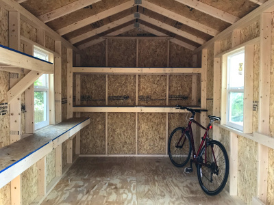 Angled workbench to allow room for the window in this upgraded interior Five Star shed.