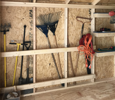 Customized shelves and storage for sporting goods in a shed.