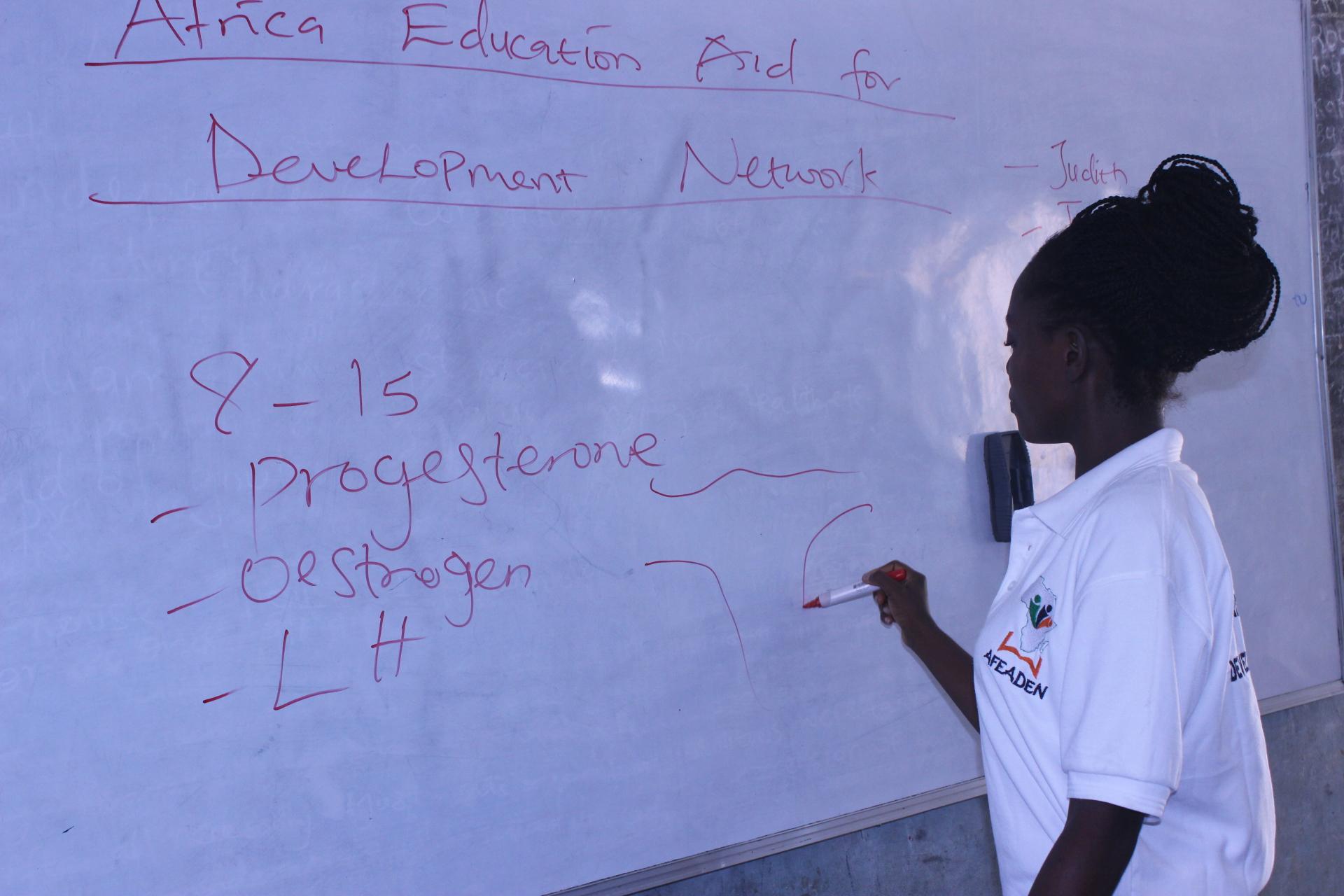 A volunteer Doctor teaching a class
