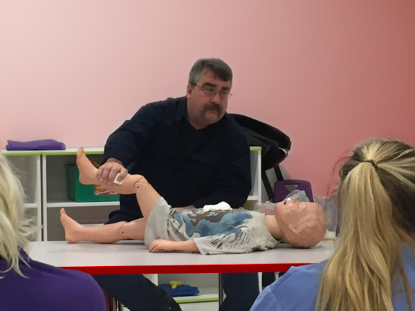 Jon Viscione,  owner of CPR Associates of New England, teaching CPR First AID course to Daycare providers