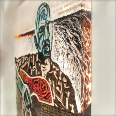 pyrography art, man playing guitar, side view