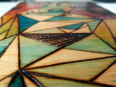 Colorful, geometric art on wood canvas, closeup