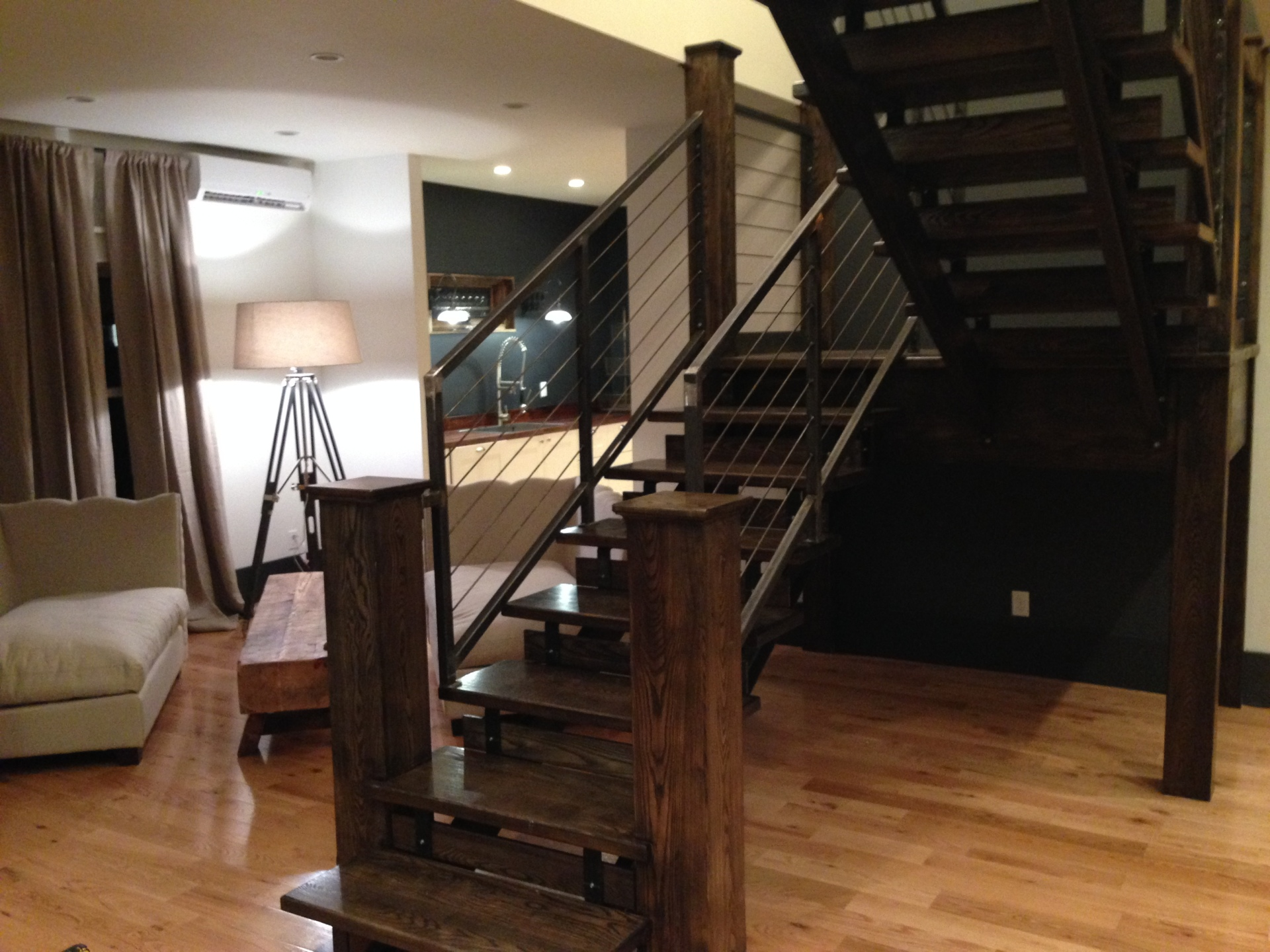 The Montauk ~ Three story stairwell dividing two comfortable living areas