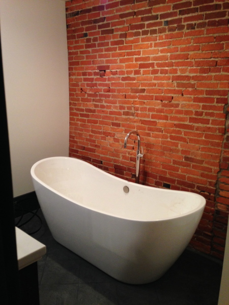 The Montauk ~ Bedroom 1 with its own private bath (double vanity, separate spa shower and soaking tub)