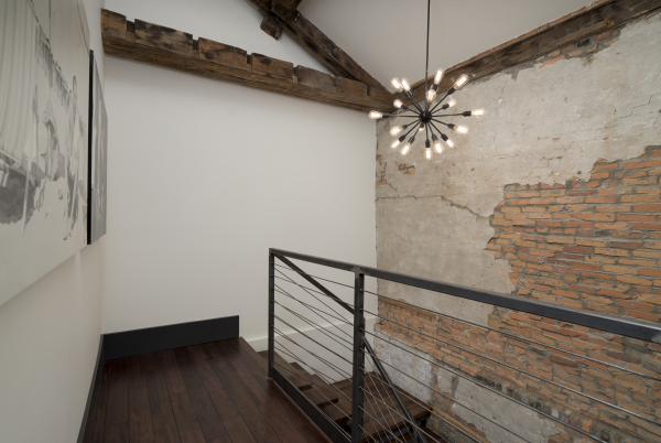 The SoHo ~ Open stairwell with exposed brick from original construction c.1823