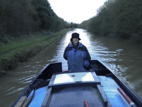 Tanya steering a narrowboat on the Ashby Canal