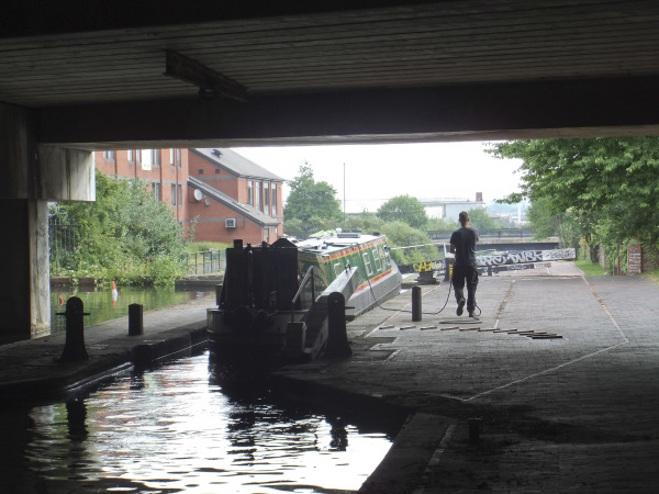 Pulling a heavy narrowboat to the side at Aston Top Lock