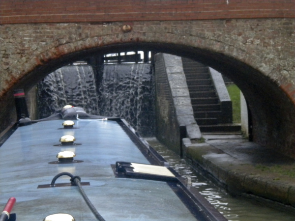 Approaching an overflowing lock on the Grand Union Canal