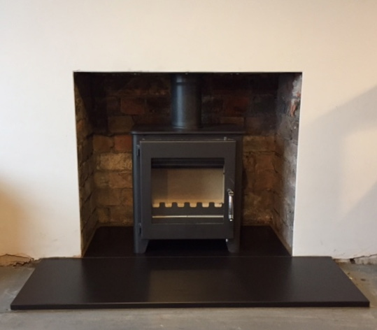 Wood burning stove, slate hearth,