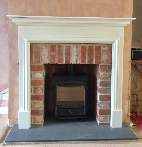 Fireplace surround, brick fireplace opening, wood burning stove