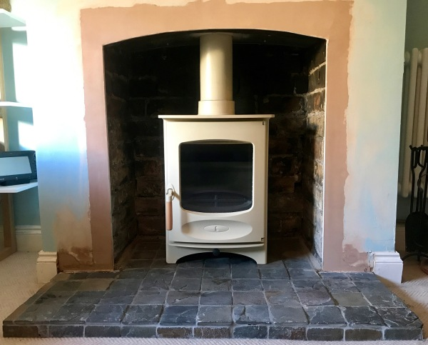 wood burning stove, arch fireplace opening, cream stove, stove installation