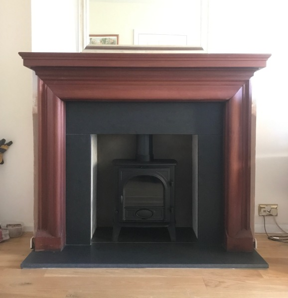 Fireplace installation, honed granite hearth, multi fuel stove installation