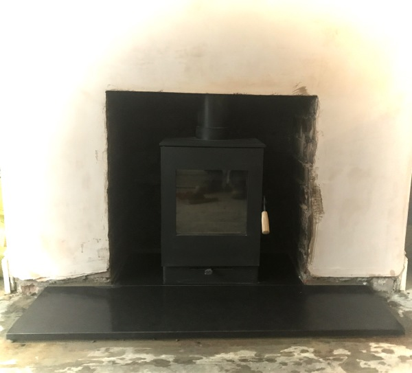 Wood burning stove, granite hearth, stove installation