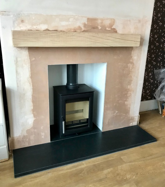 Oak beam, granite hearth, wood burner, stove installation
