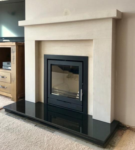 Limestone fireplace installation, inset wood burner installation