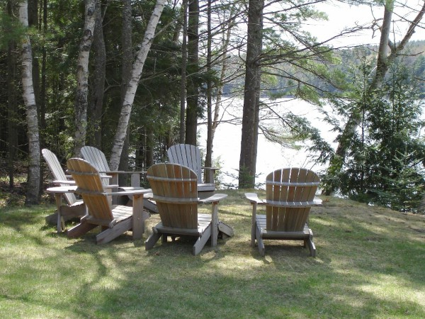 Adirondack chairs by the water